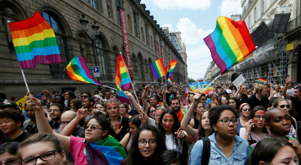 Participants take part in the annual Gay Pride parade in Paris, France.