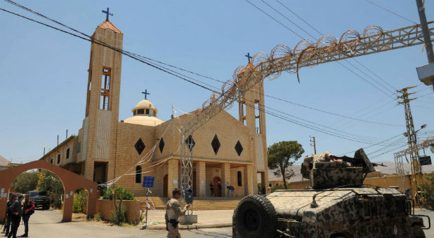 Lebanese army soldiers patrol near a church outside which suicide bombers blew themselves up in the Christian village of Qaa, in the Bekaa valley, Lebanon June 28, 2016.