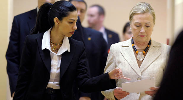 Former Secretary of State Hillary Clinton and long-time aide Huma Abedin
