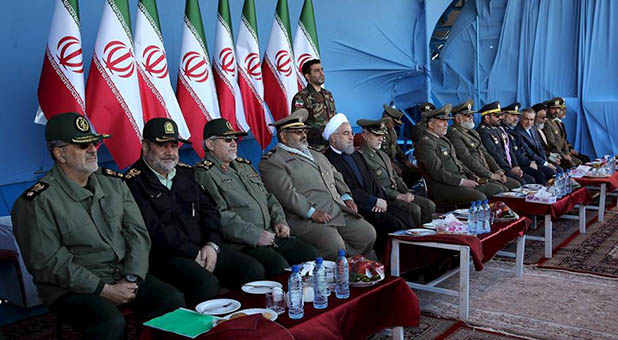 Iranian President Hassan Rouhani and military leaders