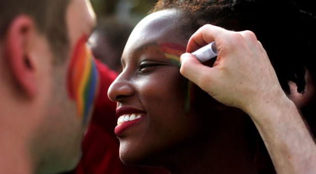 Participants get ready as they attend a gay pride parade promoting lesbian, gay, bisexual and transgender rights.