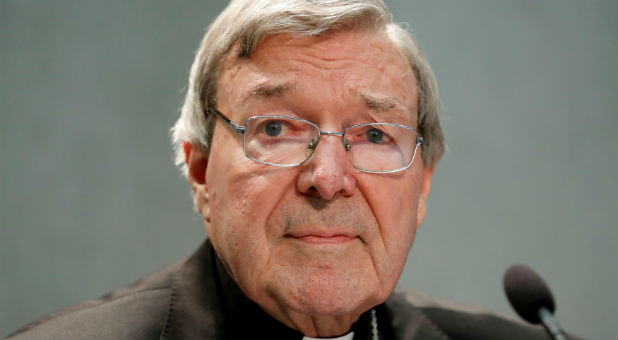 Cardinal George Pell attends news conference at the Vatican.