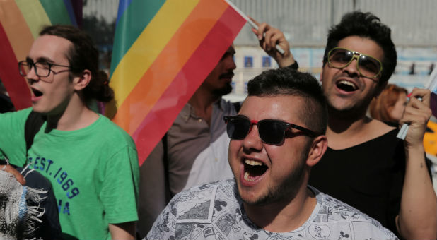 LGBT rights activists shout slogans as they try to gather for a pride parade.