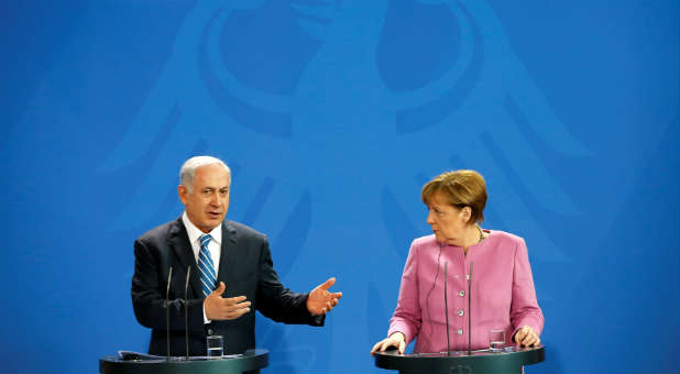 Israeli Prime Minister Benjamin Netanyahu and German Chancellor Angela Merkel address a news conference at the Chancellery in Berlin, Germany.