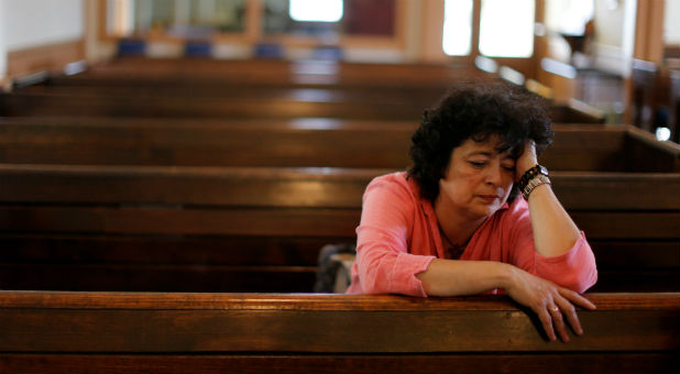 Immigrant Rosa Sabido sits in the United Methodist Church in which she lives while facing deportation in Mancos, Colorado.