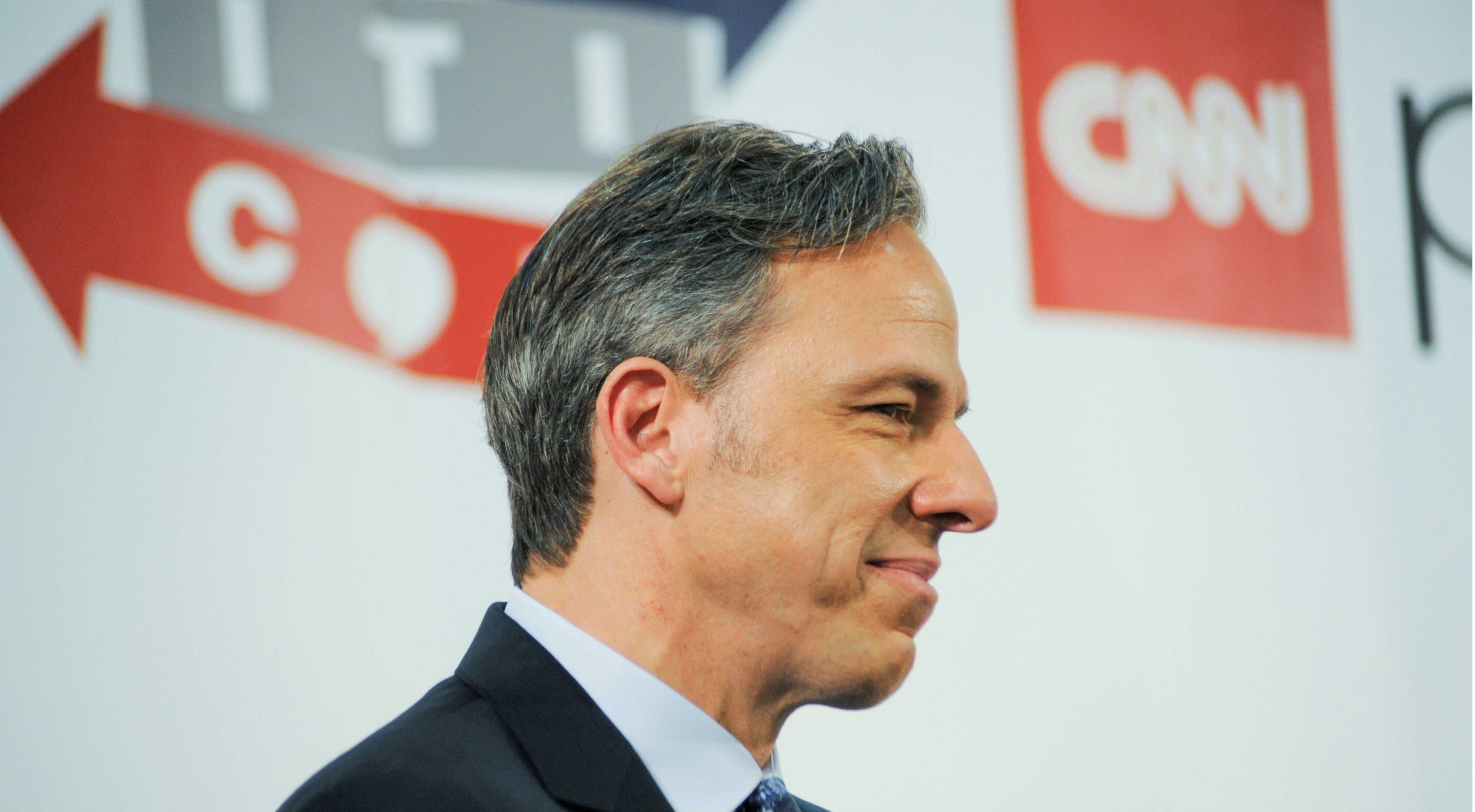 "CNN anchor Jake Tapper appears on stage at Politicon, ""the unconventional political convention"", at the Pasadena Convention Center in Pasadena, California, July 29, 2017."