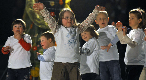 Children with Down syndrome perform during a humanitarian concert for children with Down syndrome in Kranj, March 12, 2010.