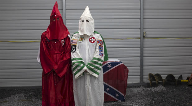Female members of the Virgil Griffin White Knights, which claims affiliation with the Ku Klux Klan, pose for a photograph in their robes ahead of a cross lighting ceremony at a private farmhouse in Carter County, Tennessee, July 4, 2015.