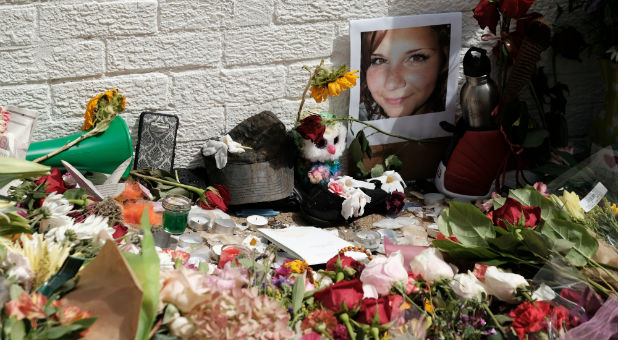 Flowers and a photo of car ramming victim Heather Heyer lie at a makeshift memorial in Charlottesville, Virginia.