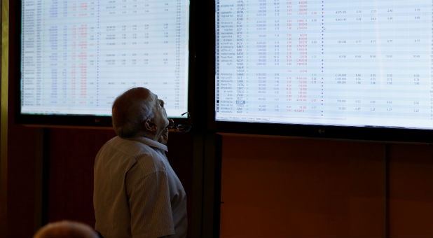 Investors monitor prices at the Iraq Stock Exchange in Baghdad, Iraq, Aug. 2, 2017.