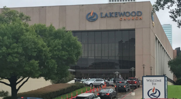 Vehicles queue to deliver supplies for Hurricane Harvey evacuees at the nondenominational Lakewood Church, founded by pastor Joel Osteen, in Houston, Texas, U.S. Aug. 29, 2017.