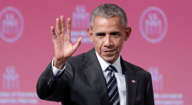 Former U.S. President Barack Obama waves after his keynote speech to the Montreal Chamber of Commerce,