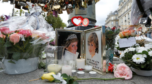 A small memorial at the location where Princess Diana was in a fatal car wreck.