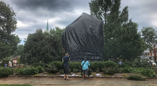 The statue of Confederate General Robert E. Lee is shown covered in black tarp in Charlottesville, Virginia.