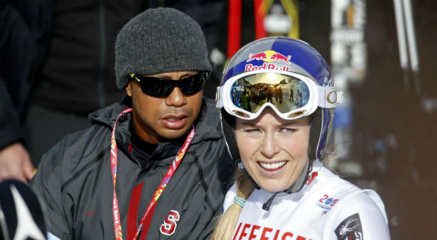 Lindsey Vonn of the United States (right) stands with boyfriend Tiger Woods after run one of the women's giant slalom in the FIS alpine skiing world championships at Raptor Racecourse.