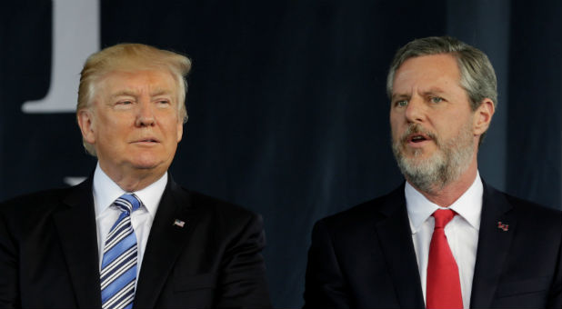 U.S. President Donald Trump (L) stands with Liberty University President Jerry Falwell Jr. after delivering keynote address at commencement in Lynchburg, Virginia.