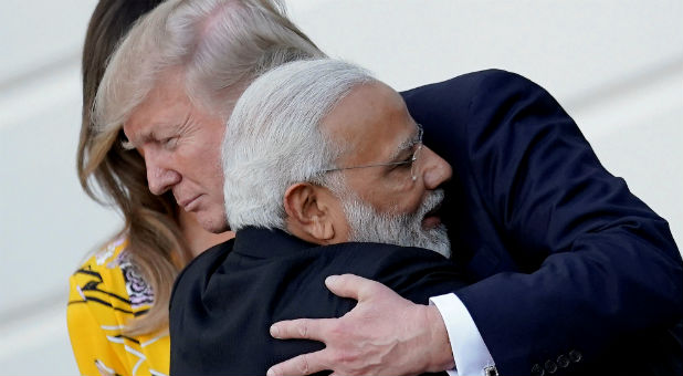 India's Prime Minister Narendra Modi hugs U.S. President Donald Trump as he departs the White House after a visit, in Washington, D.C.