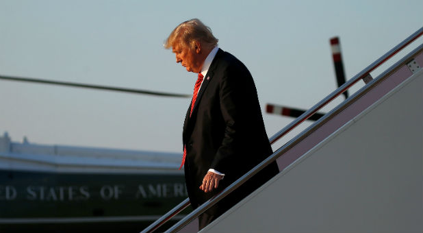 U.S. President Donald Trump walks from Air Force One as he arrives at Joint Base Andrews, Maryland.