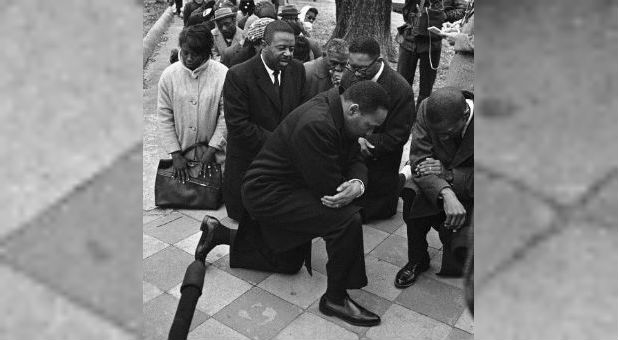 Martin Luther King Jr. takes a knee.