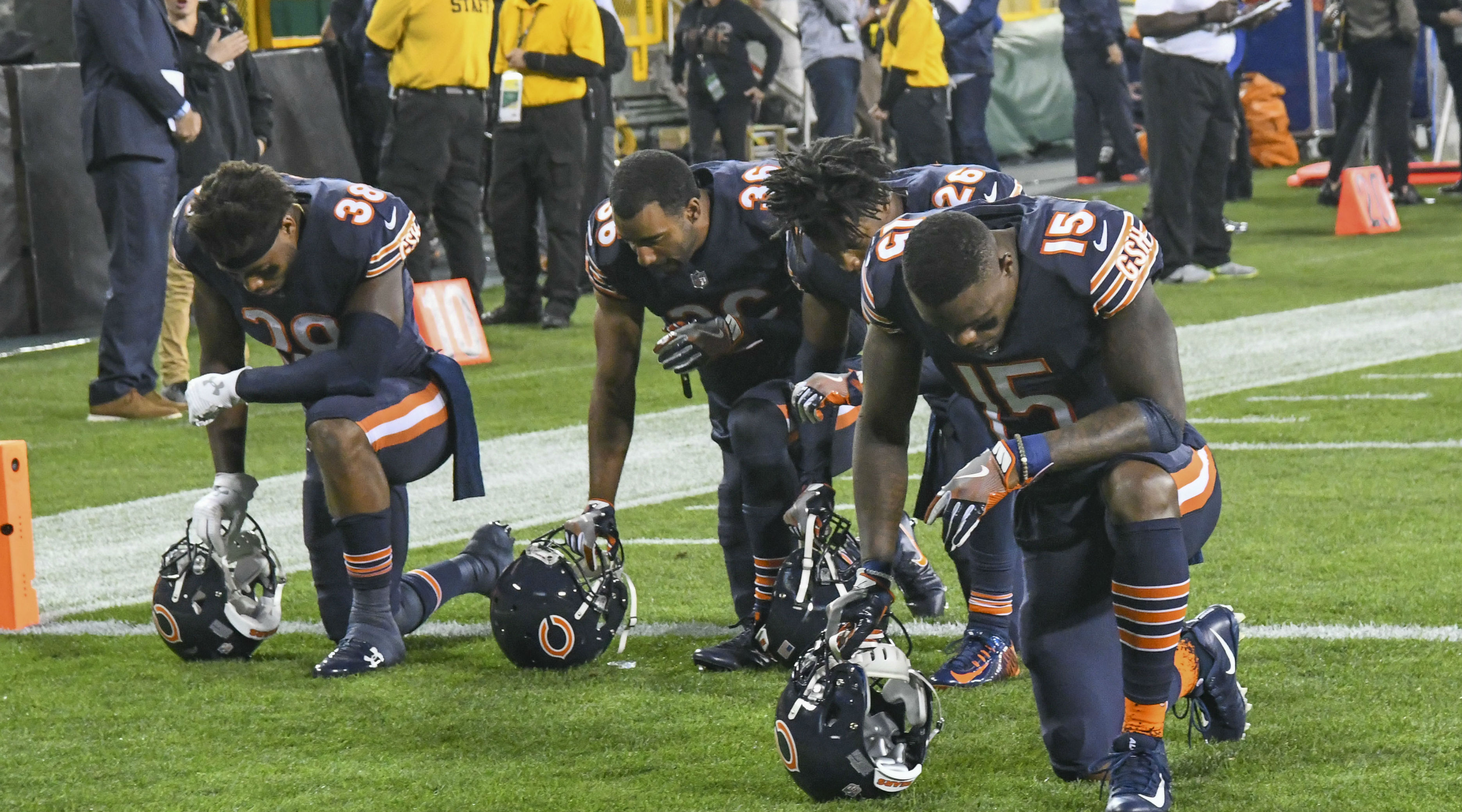 Athletes kneel to protest racial injustice.