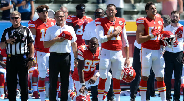 Kansas City Chiefs defensive end Chris Jones (95) kneels in protest during the national anthem.