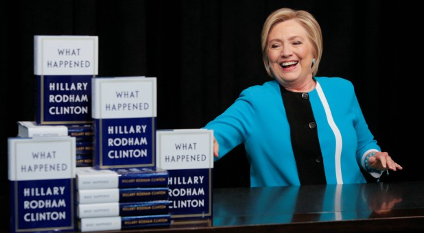Hillary Clinton poses with her new book.