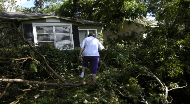 A woman evaluates her Jacksonville, Florida, home after Hurricane Irma.