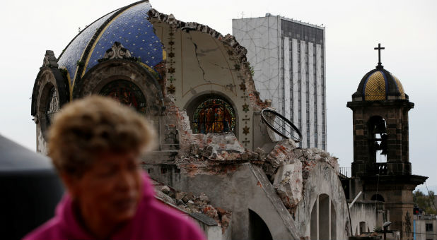 A person walks past the church dome of Our lady of los Angeles, which collapsed six days after an earthquake, in Mexico City, Mexico.
