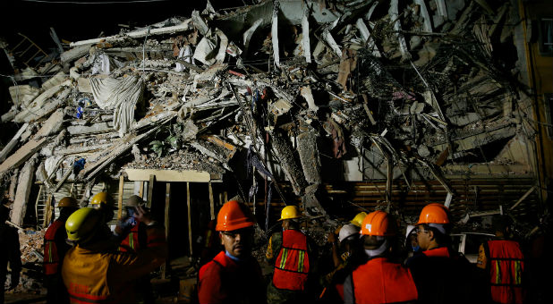Rescuers work at the site of a collapsed building after an earthquake in Mexico City, Mexico.