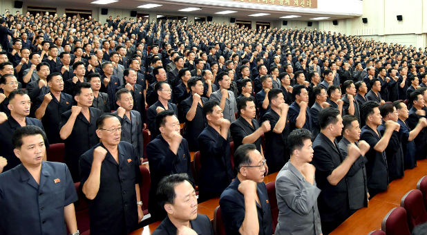 A meeting of DPRK of the central committee is held as they vow a sacred war against the U.S.