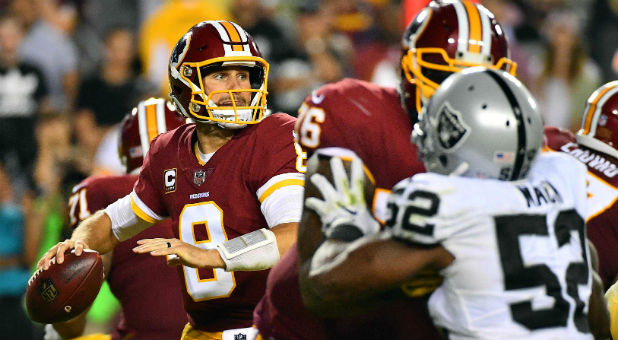 Washington Redskins quarterback Kirk Cousins (8) drops back to pass against the Oakland Raiders.