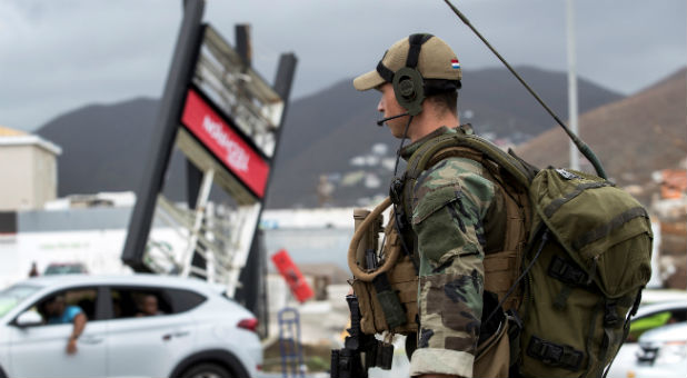 A soldier evaluates damage in Sint Maarten.