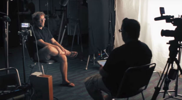 Darren Wilson, right, records an interview.