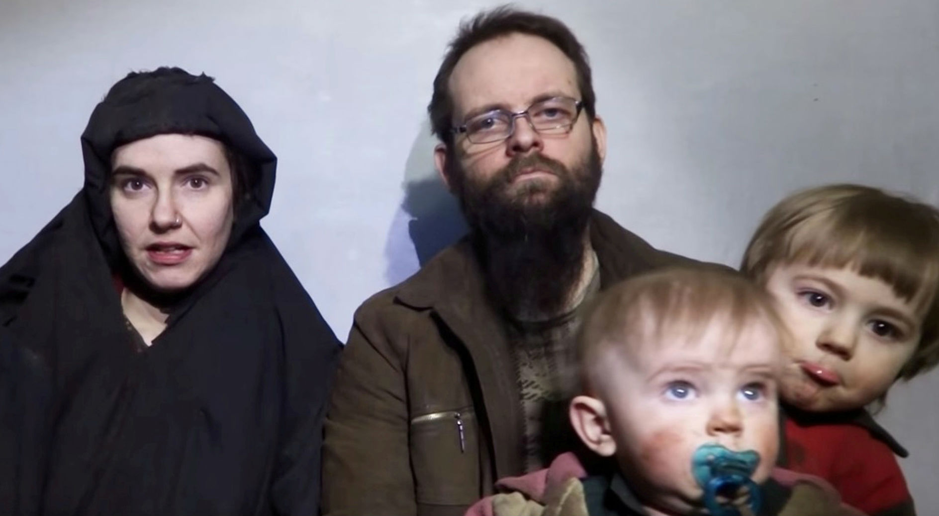 A still image from a video posted by the Taliban on social media on Dec. 19, 2016, shows American Caitlan Coleman (L) speaking next to her Canadian husband Joshua Boyle, and their two sons.