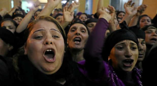 Coptic Christians react after a deadly attack.
