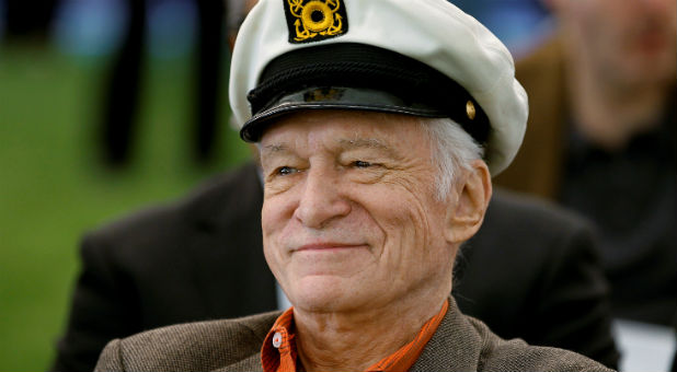 """Playboy"" magazine founder Hugh Hefner smiles at the news conference in 2011."
