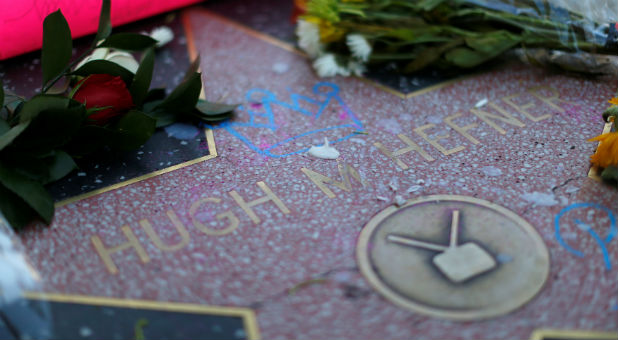 The star of late publisher Hugh Hefner is adorned with flowers and other items on the Hollywood Walk of Fame.