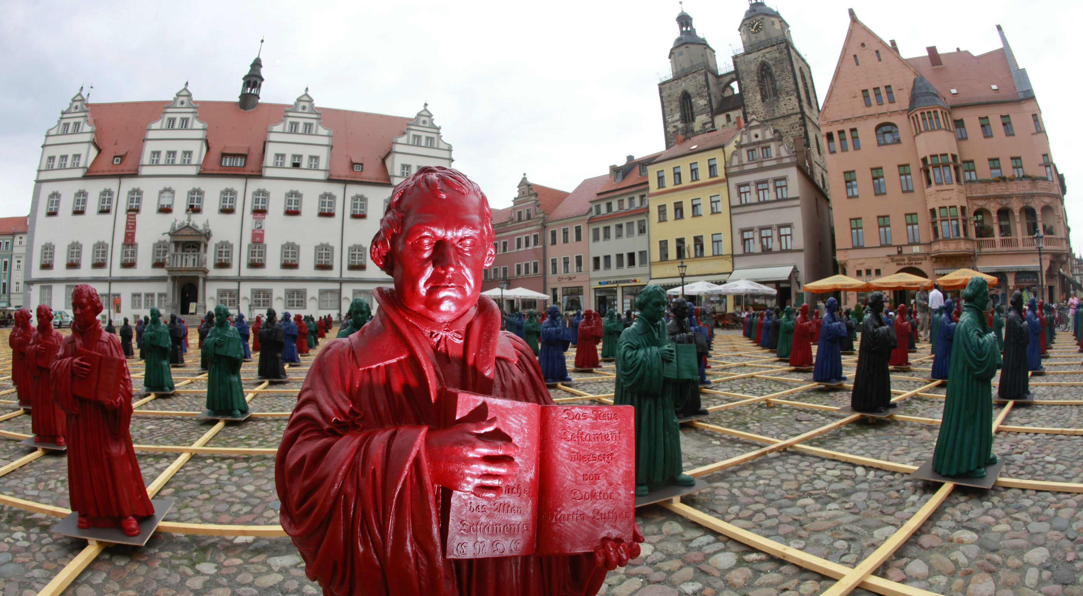 An art exhibit features plastic statues of Martin Luther.