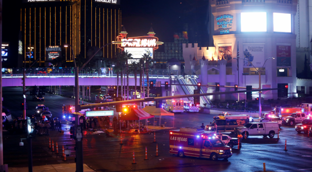 Las Vegas Metro Police and medical workers stage in the intersection of Tropicana Avenue and Las Vegas Boulevard South after a mass shooting at a music festival.