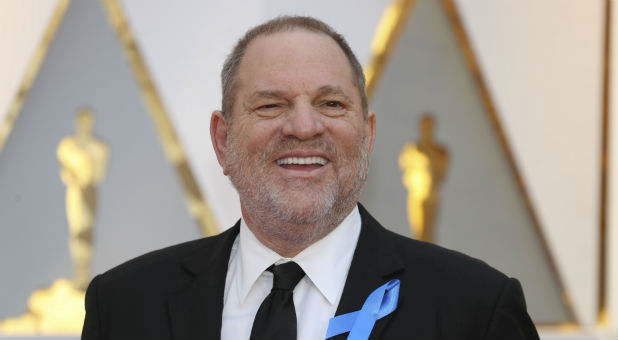 Harvey Weinstein poses on the Red Carpet after arriving at the 89th Academy Awards in Hollywood, California.