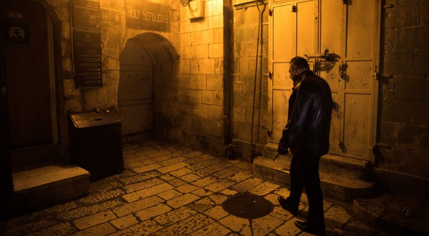 Adeeb Joudeh, a Muslim, walks as he holds the church key in Jerusalem's Old City.