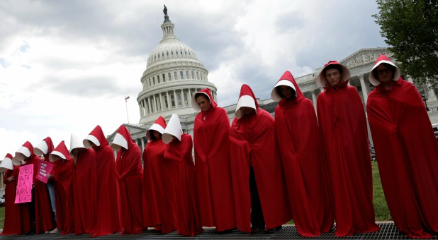 "Women dressed as handmaids from the novel, film and television series ""The Handmaid's Tale"" demonstrate against cuts for Planned Parenthood in the Republican Senate health care bill at the U.S. Capitol."
