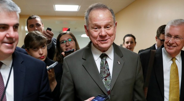 Roy Moore, center
