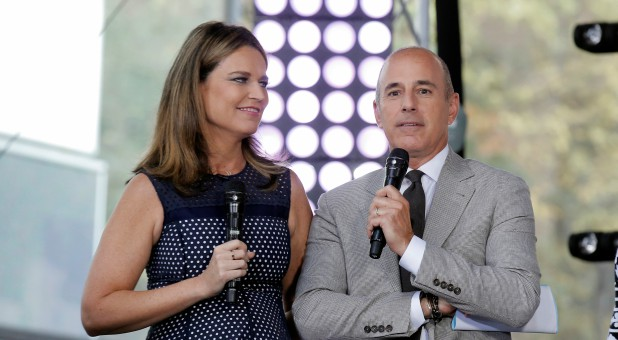 "Hosts Savannah Guthrie (L) and Matt Lauer appear during NBC's ""Today"" show Summer Concert Series."
