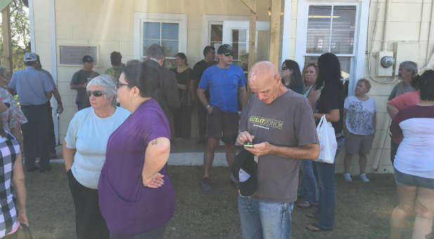 Sutherland Springs, Texas, residents gather after the tragic mass shooting.