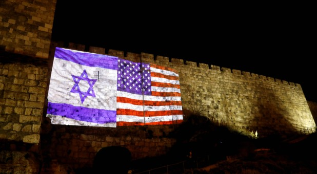 An Israeli national flag and an American one are projected on a part of the walls surrounding Jerusalem's Old City.