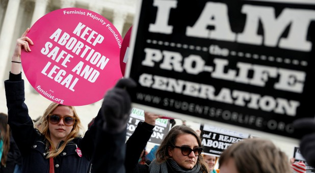 Pro-life and pro-choice activists gather at the Supreme Court for the National March for Life rally in Washington.