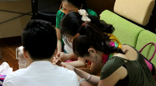 Christians pray together in Beijing.