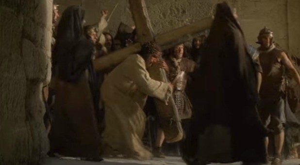Jim Caviezel carries the cross in 'Passion of The Christ.'