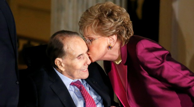 Former Senate majority leader Bob Dole (R-KS) receives a kiss from his wife Elizabeth Dole during a Congressional Gold Medal ceremony.
